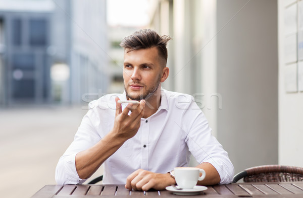 Man koffie smartphone stad cafe business Stockfoto © dolgachov