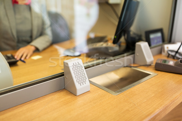 clerk at bank office or currency exchanger Stock photo © dolgachov