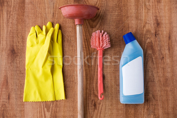 plunger with cleaning stuff on wooden background Stock photo © dolgachov