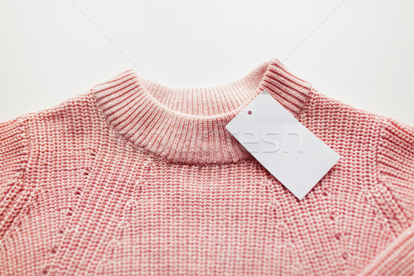 close up of sweater or pullover with price tag Stock photo © dolgachov