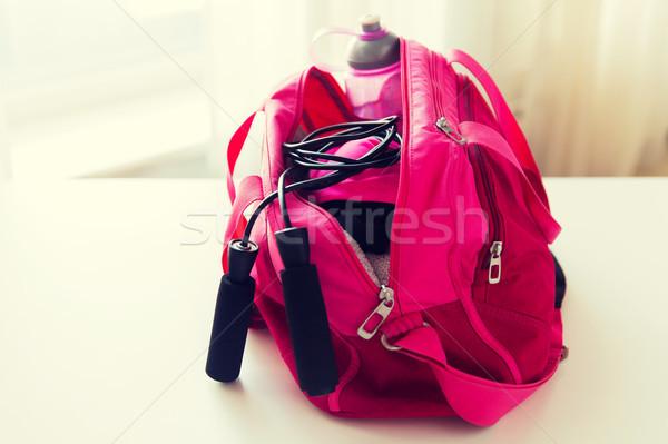 close up of female sports stuff in bag Stock photo © dolgachov