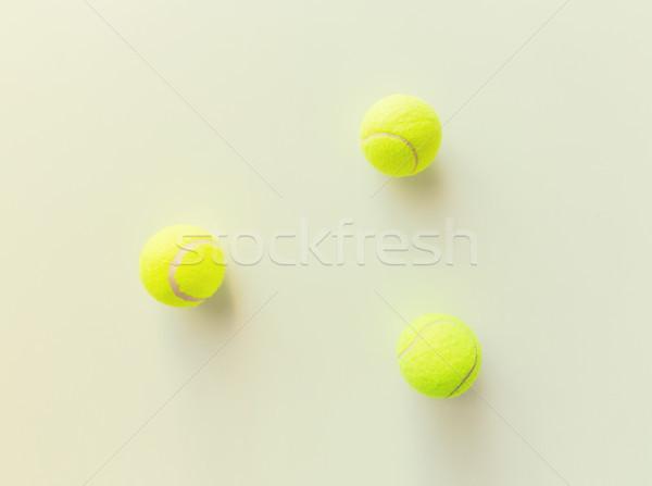 Közelkép három citromsárga tenisz golyók sport Stock fotó © dolgachov