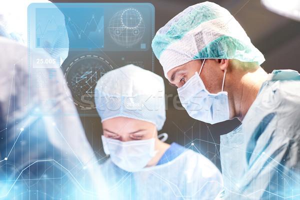 Csoport sebészek műtő kórház műtét egészségügy Stock fotó © dolgachov