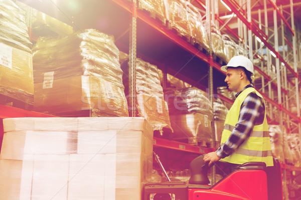 男 フォークリフト 貨物 倉庫 ストックフォト © dolgachov