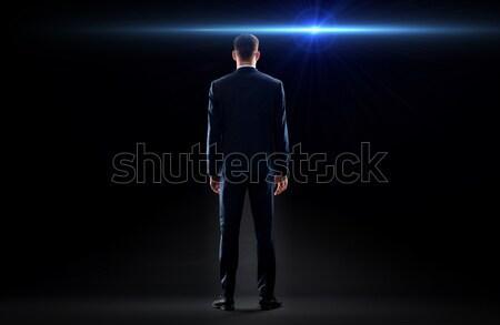 businessman in suit over black Stock photo © dolgachov