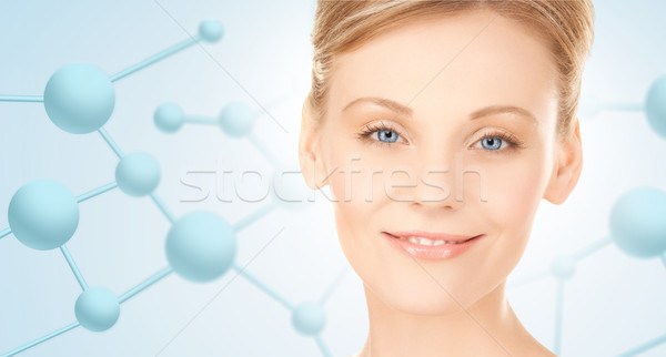 beautiful young woman face with molecules Stock photo © dolgachov