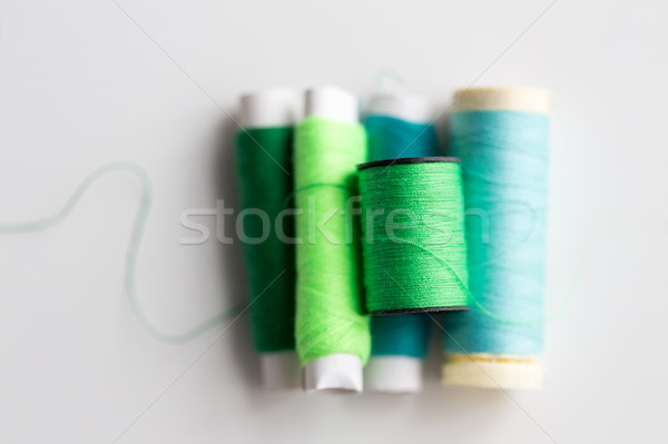 green and blue thread spools on table Stock photo © dolgachov