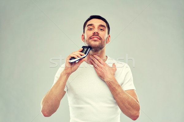 Sorridente homem barba cinza beleza Foto stock © dolgachov
