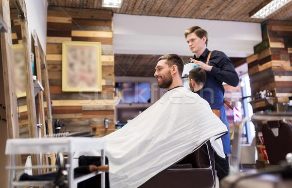Homme salon de coiffure miroir coiffure personnes heureux Photo stock © dolgachov