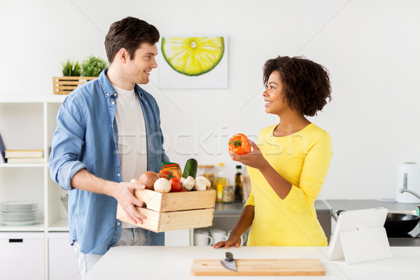 happy couple with healthy food at home kitchen Stock photo © dolgachov
