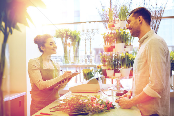 florist woman and man making order at flower shop Stock photo © dolgachov