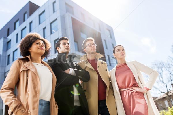international group of people on city street Stock photo © dolgachov