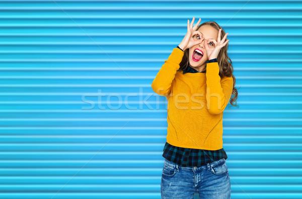 happy young woman or teen girl having fun Stock photo © dolgachov