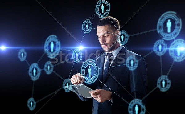 businessman with tablet pc and network contacts Stock photo © dolgachov