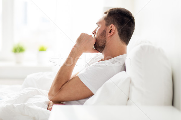 Człowiek bed domu ludzi stres Zdjęcia stock © dolgachov