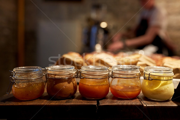 jars with craft jam or sauce at grocery store Stock photo © dolgachov