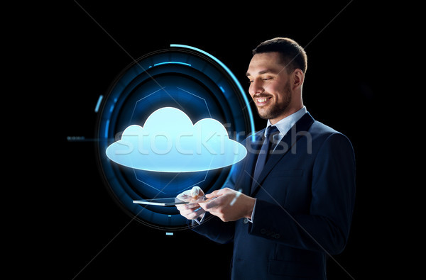 businessman with tablet pc and cloud projection Stock photo © dolgachov