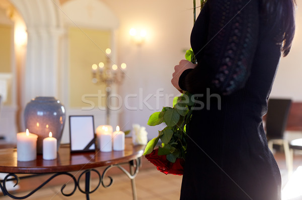 woman with cremation urn at funeral in church Stock photo © dolgachov