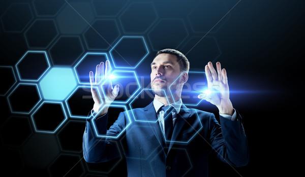 businessman working with virtual network hologram Stock photo © dolgachov