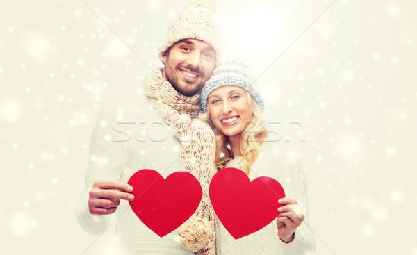 Sorridere Coppia inverno vestiti rosso cuori Foto d'archivio © dolgachov