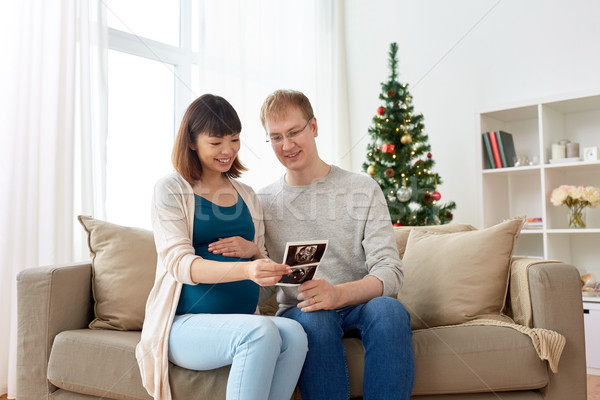 счастливым пару ультразвук Рождества беременности Сток-фото © dolgachov