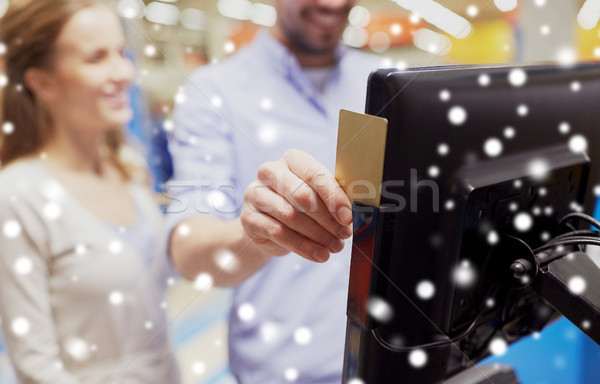 couple with customer card at store self-checkout Stock photo © dolgachov