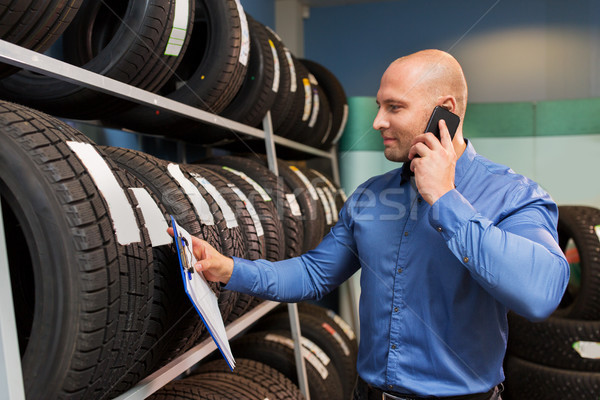 auto business owner ordering tires at car service Stock photo © dolgachov