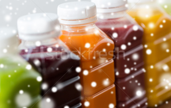 bottles with different fruit or vegetable juices Stock photo © dolgachov