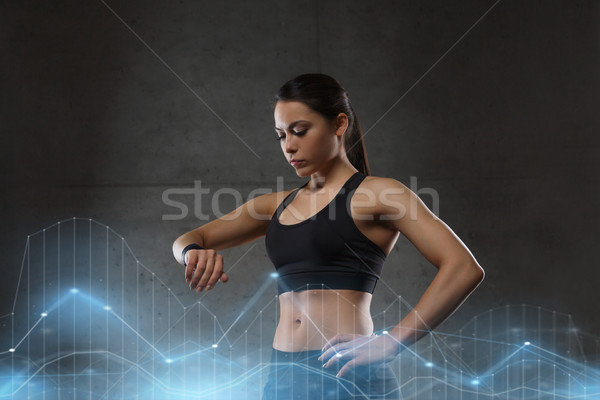 young woman with heart-rate watch in gym Stock photo © dolgachov