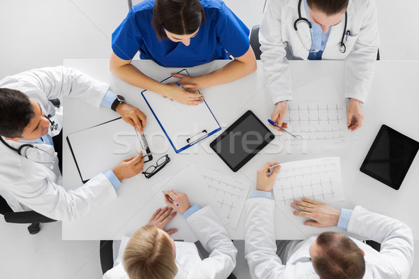 group of doctors with cardiograms at hospital Stock photo © dolgachov