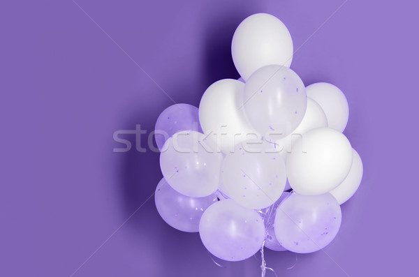 white helium balloons on ultra violet background Stock photo © dolgachov