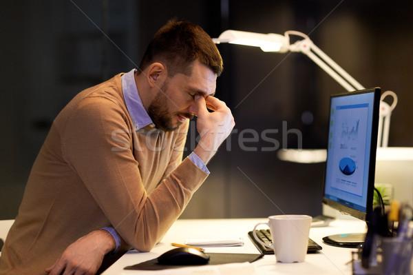 tired businessman working at night office Stock photo © dolgachov