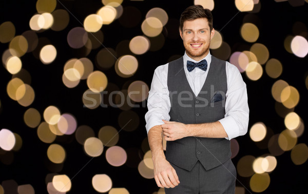 happy man in festive suit dressing for party Stock photo © dolgachov