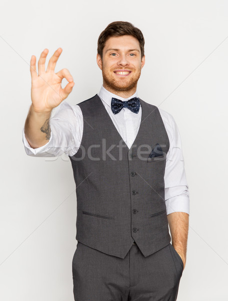 happy man in festive suit showing ok hand sign Stock photo © dolgachov