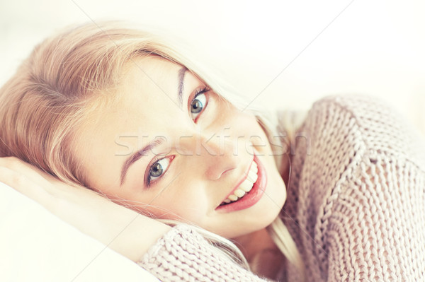 young woman or teen girl lying on pillow at home Stock photo © dolgachov