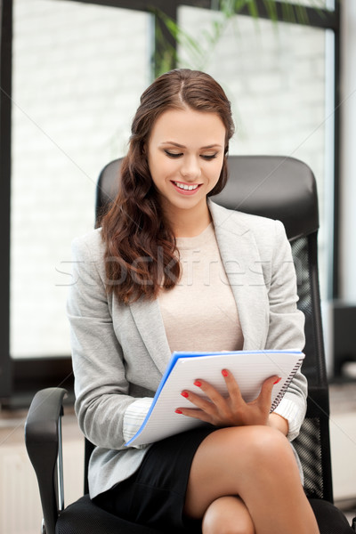 happy woman with big notepad Stock photo © dolgachov