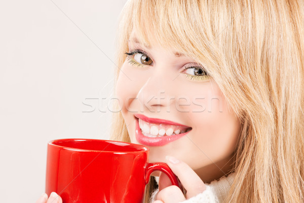 happy teenage girl with red mug Stock photo © dolgachov