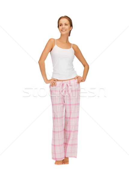 Szczęśliwy uśmiechnięta kobieta bawełny piżama jasne zdjęcie Zdjęcia stock © dolgachov