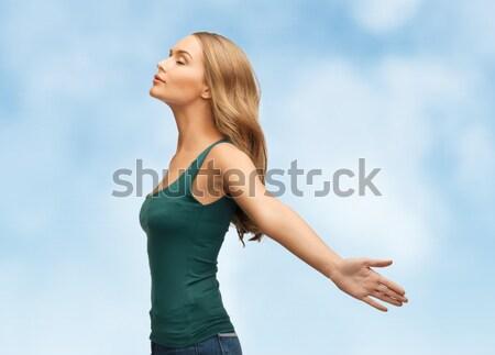 woman spreading hands Stock photo © dolgachov