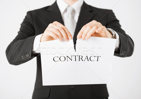 man hands tearing contract paper Stock photo © dolgachov