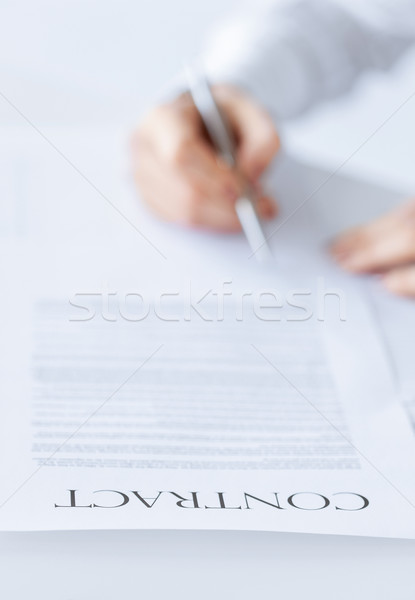 woman with contract Stock photo © dolgachov