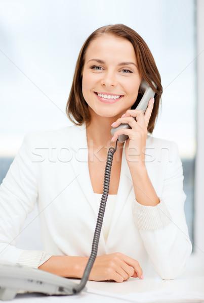 businesswoman with rotary phone calling Stock photo © dolgachov