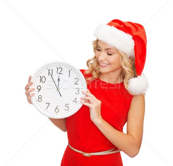 Mulher ajudante seis relógio Foto stock © dolgachov