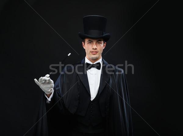 Bűvész felső kalap varázspálca mutat trükk Stock fotó © dolgachov