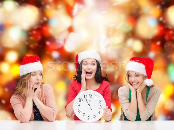 Kobiet Święty mikołaj pomocnik zegar Zdjęcia stock © dolgachov