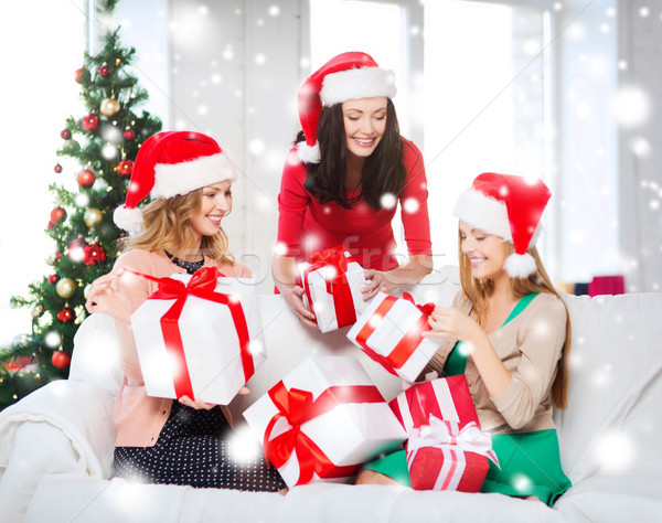 women in santa helper hats with many gift boxes Stock photo © dolgachov