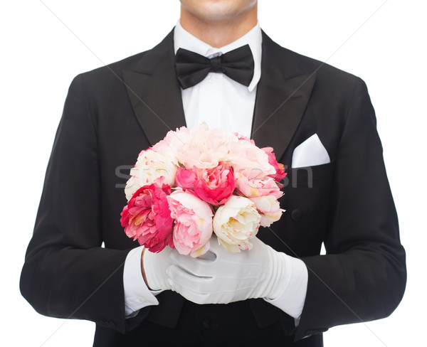 man in tail-coat with flower bouquet Stock photo © dolgachov