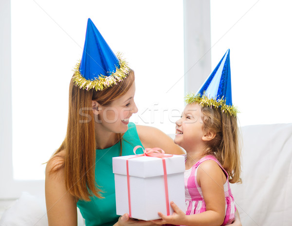 mother and daughter in blue hats with favor horns Stock photo © dolgachov