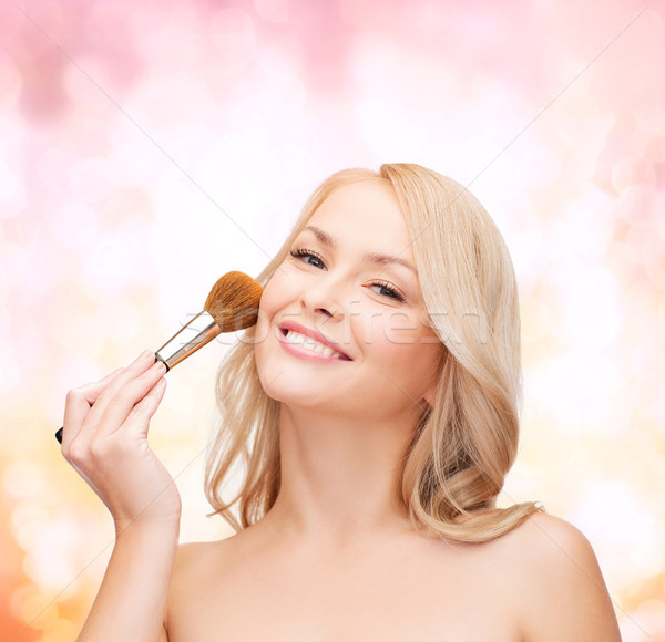 beautiful woman with closed eyes and makeup brush Stock photo © dolgachov