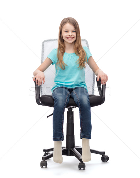 smiling little girl sitting in big office chair Stock photo © dolgachov